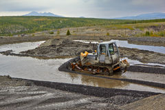 Gold mining in Susuman. The bulldozer and derocker. The Magadan area. Kolyma Royalty Free Stock Photos