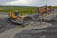 Gold mining in Susuman. The bulldozer and derocker stock photo