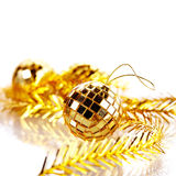 Gold mirror sphere and New Years tinsel. Stock Image