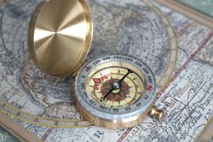 Free Gold Modern Compass On An Old Map Royalty Free Stock Image - 134994406