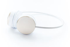 Gold modern headphone on white isolated Royalty Free Stock Photography