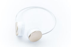 Gold modern headphone on white isolated Stock Image