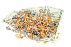 Gold and money. Gold jewelry and dollars on white background Stock Image