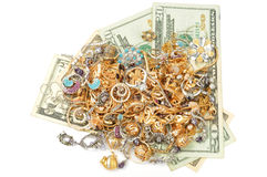 Gold and money. Gold jewelry and dollars an white background Stock Photo