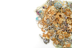 Gold and money. Platinum and yellow gold jewelry and dollars Royalty Free Stock Images