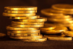 Gold money coin stacking on dark background. Close up gold money coin stacking on dark background Royalty Free Stock Photography
