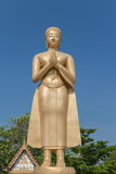 The gold monk statue. Standing  and greeting Royalty Free Stock Photos