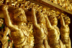 "Gold monkey. This is a monkey carve in Buddhism. It is make by carve wood. It is located in ""Chiang Mai City"" at thailand royalty free stock image"