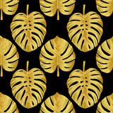 Gold Monstera Seamless Pattern. Seamless pattern of tropical gold monstera leaves isolated on black. Tropical wallpaper, textile print, exotic background Stock Photography