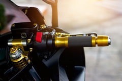 Gold motorcycle handle on street background Stock Images