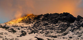 Gold mountain peak on sunset. High Tatras royalty free stock photography