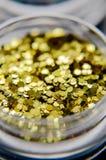 Gold nail glitters close up. Royalty Free Stock Photos