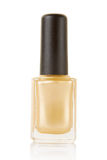 Gold nail polish bottle Royalty Free Stock Image