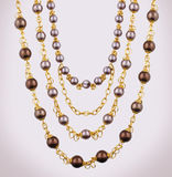 Gold necklace. With dark pearls Royalty Free Stock Images