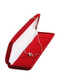 Gold necklace. In red jewel box on white background Stock Photos