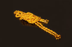 Gold necklace. 2 gold necklace in black background Royalty Free Stock Images