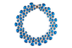 Gold necklace with blue rhinestones Royalty Free Stock Photos