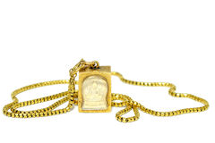 Gold necklace with Buddha amulet Stock Photography