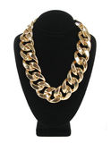 Gold necklace chain on velvet stand isolated on white, fashion jewelry Royalty Free Stock Images
