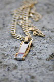Gold necklace on a concrete Stock Photography