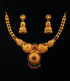 Gold Necklace With Earrings. Indian Traditional Gold Necklace With Earrings Royalty Free Stock Photography