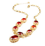 Gold necklace with gems isolated Stock Images