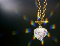 Gold necklace with a heart Royalty Free Stock Photos