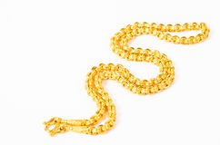 Gold necklace isolated on white. Royalty Free Stock Image