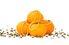 Gold necklace and mandarin oranges Royalty Free Stock Photography