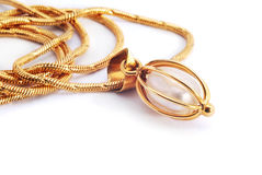 Gold necklace with pearl Stock Images