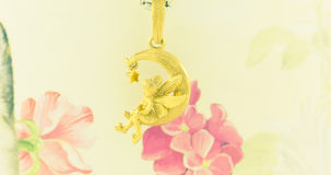 Gold necklace pendant fairy Royalty Free Stock Photography