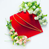 Gold necklace 96.5 percent Thai gold grade with flowers putting Royalty Free Stock Photo
