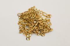 Gold necklace in pile Royalty Free Stock Image
