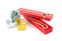 Gold necklace in red box Stock Image