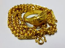 Gold necklace and ring Royalty Free Stock Photography