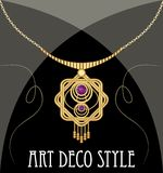 Gold necklace star shape with purple ametyst on fine golden chain, elegant vintage jewel in art deco style Royalty Free Stock Photography