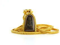 Gold necklace with thai buddha amulet in gold frame isolated on Stock Photography