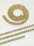 Gold necklaces and bracelets. On white background Royalty Free Stock Photos