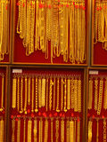 Gold necklaces for sale, Bangkok, Thailand. Gold necklaces and bracelets in a display case for sale in Bangkok, Thailand Royalty Free Stock Photos
