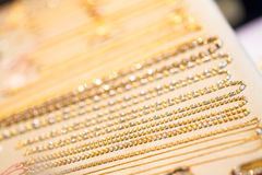 Gold necklaces. Shining in shop Royalty Free Stock Photography