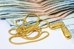 Gold Necklece with Cash Royalty Free Stock Photo