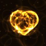 Gold neon plasma laser heart on dark background. Yellow blue laser heart made from circles on dark background. Fire Heart from bubbles in the dark Stock Images
