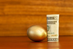 Gold nest egg placed on wood grain background Stock Photos