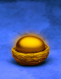 Gold Nest Egg Superannuation. A gold egg in a nest with a blue background royalty free stock photos