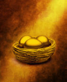 Gold Nest Eggs Superannuation. A nest with three golden eggs and a shaft of light Stock Images