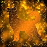 New Year 2018 background. Gold New Year bokeh background with a dog. Concept New Year and Christmas 2018. For greeting cards, flyers and invitations Stock Images