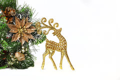 Gold New Year deer and sledge isolated Stock Photos