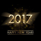 Gold New Year 2017 greeting card background. Gold New Year 2017 card. Happy New Year background with glowing lens flare effect sparkling stars texture. Stardust Stock Photo