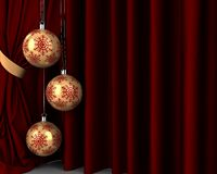 Gold New Year's balls in front of red drapery. New Year Royalty Free Stock Images