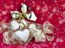 Gold New Year's hearts and decorative ribbon Stock Images